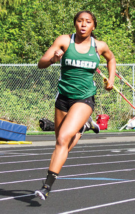 Marysville Getchell's Kiarra Green comes around the corner for the final leg of the 4x200-meter relay at Arlington High School on May 9. - Andrew Hines, NC Outlook