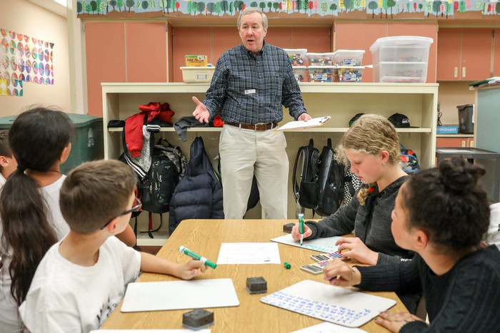 John Bloom has been volunteering in area schools since his retirement in 2004. (Lizz Giordano / The Herald)
