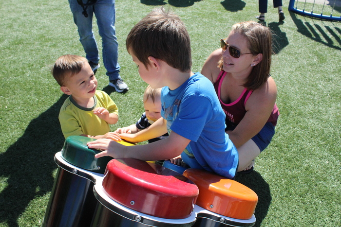 Kids play on new inclusive playground Ribbon Cutting