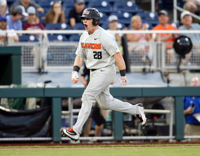 Oregon State designated hitter Kyle Nobach, a graduate of Marysville Pilchuck High School, celebrates after hitting a three-run home run against Washington in the seventh inning of an College World Series elimination game on June 18, 2018, in Omaha, Neb. (AP Photo/Nati Harnik)