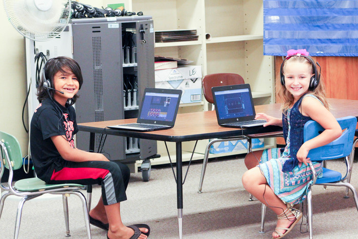 Image: Two elementary students on computers