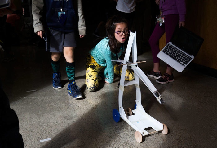 Marshall Elementary fifth-grader Talia Gibbs reacts as her team's gravity car goes farther than previous attempts during a one week engineering program at the University of Washington on Wednesday, Sept. 12, 2018 in Seattle, Wa. (Andy Bronson / The Herald)