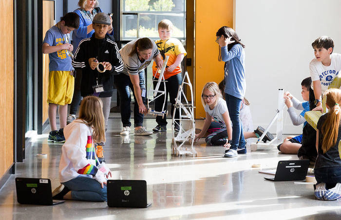 Fifth-grade students from Marshall Elementary in Marysville build test and remodel gravity cars, as part of a one week engineering program, in a hall at the University of Washington on Wednesday, Sept. 12, 2018 in Seattle, Wa. (Andy Bronson / The Herald)
