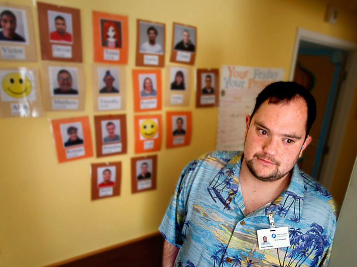 Preston Dwoskin, 26, is a former student in the Marysville School District's 18-21 program, part of special education. He now is employed by the transition program, guiding other students toward work opportunities. Born with profound hearing loss, he has been an advocate for people with disabilities. (Dan Bates / The Herald)