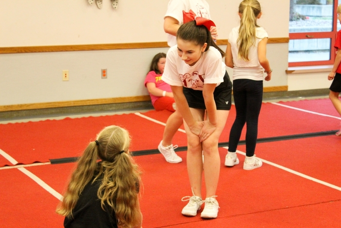 cheerleader talking to camp.participant