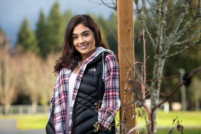 Marysville Mountain View senior Anita Bradford-Diaz, a former dropout, holds down a full-time job while taking extra classes in her quest to earn a diploma. (Andy Bronson / The Herald)