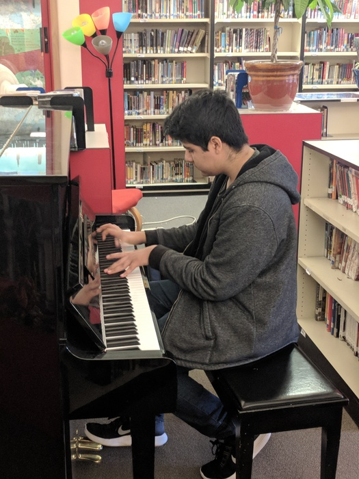 Photo of Student at Cedarcrest Playing Piano