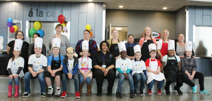 2018 Future Chef Photo of students with food service helper