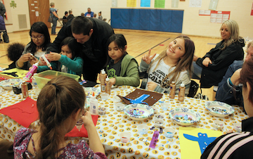 Photo of Kids doing Native Crafts at Liberty Elementary during Native Education Night