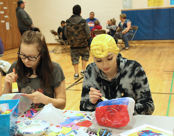 Photo of two students doing crafts